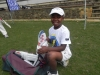 happy-kid-with-his-new-kit-donated-to-him